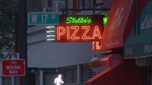 sign for stella's pizza in nyc - viewpoint stock videos & royalty-free footage