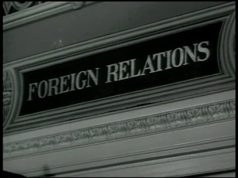 Sign 'Foreign Relations' INT Room w/ Senate Foreign Relations Committee at table Senators Henrik Shipstead Arthur Vandenberg Robert LaFollette Hiram...