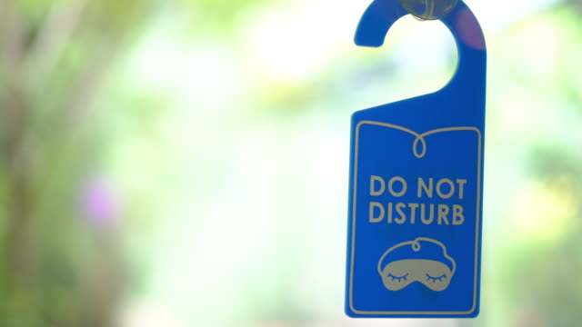 do not disturb sign hanging on the mirror door at the hotel room - capital letter stock videos & royalty-free footage