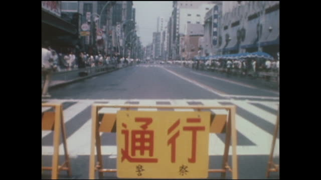 """a sign hangs from a barrier on the newly opened """"pedestrian paradise""""; onlookers watch as a man scoops goldfish out of a tub. - washtub stock videos and b-roll footage"""