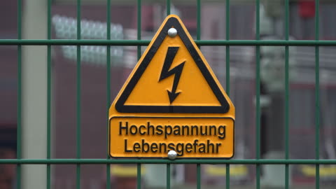 sign high voltage, danger of life, on fence - high voltage sign stock videos & royalty-free footage