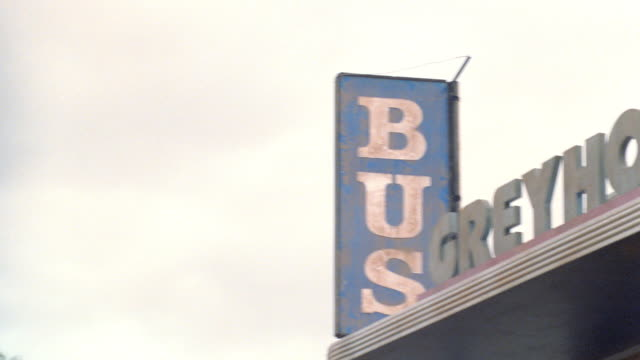 """a sign identifies a building as a """"greyhound bus depot"""". - 1998 stock videos & royalty-free footage"""