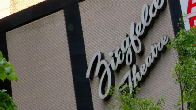 A sign identifies a building as Ziegfeld Theatre.