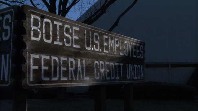 a sign identifies the boise u.s. employee federal credit union. - credit union stock videos & royalty-free footage