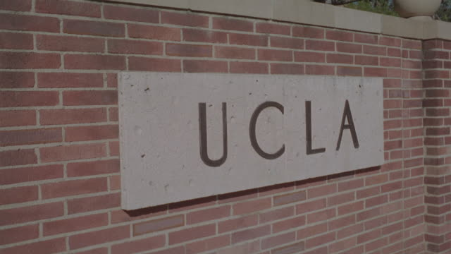 A sign identifies the entrance to the UCLA campus.