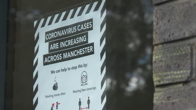 sign in a window in manchester advising people that coronavirus cases are rising - manchester england stock videos & royalty-free footage