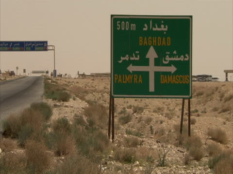 Sign in desert for Palmyra, Damascus and Baghdad, Syria (sound available)