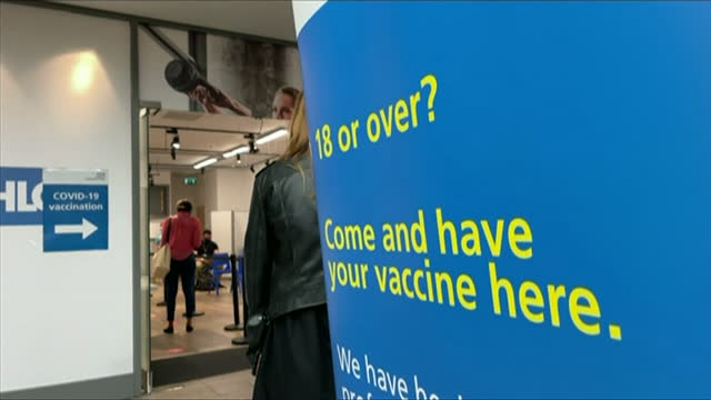 sign in leeds calling for people 18 or over to have their covid vaccines - young adult stock videos & royalty-free footage
