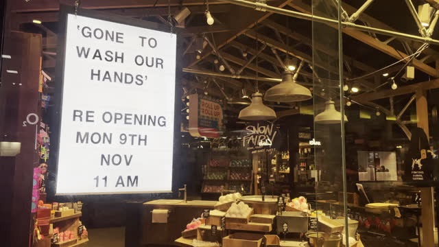 """sign in the window of a lush retail store on the first saturday night of the """"firebreak"""" which is aimed at reducing the number of covid-19 cases on... - lush stock videos & royalty-free footage"""