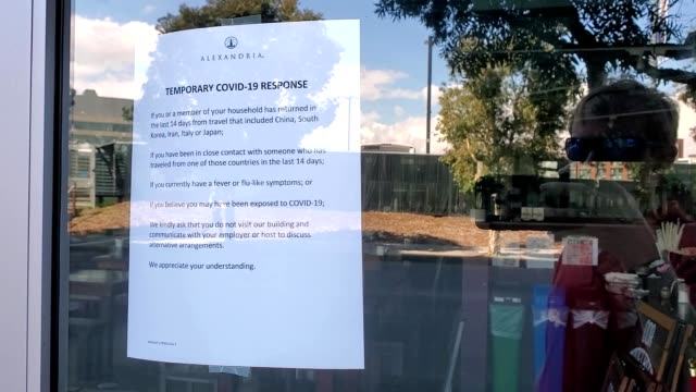 sign in window announcing business impacts during an outbreak of the covid-19 coronavirus in san francisco, california, march 19, 2020. - bay window stock videos & royalty-free footage