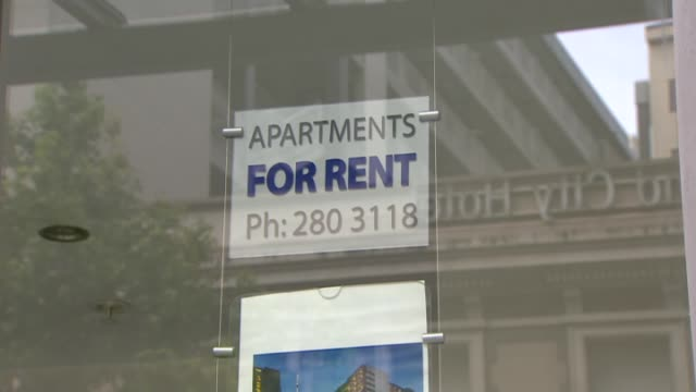 Sign in window of real estate office advertising apartments for rent