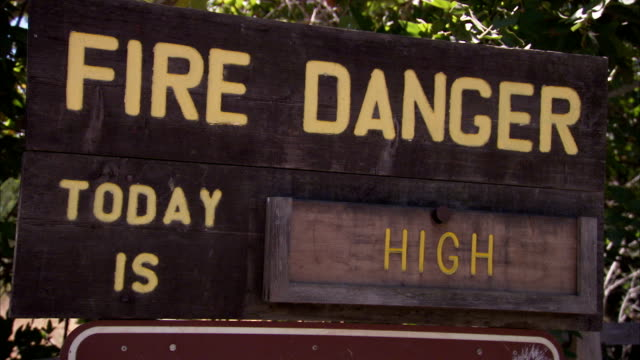 A sign in Yosemite National Park warns that the fire danger as high.