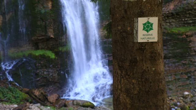 "sign indicates that you are in a nature reserve, near the waterfall at ""cirque de saint meme"" a popular tourist site on september 3, 2020 in saint... - water stock videos & royalty-free footage"