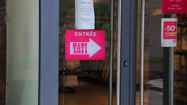 sign indicates the entrance of the famous flagship tati store on july 8, 2020 in paris, france. cut-price clothing chain falls victim to changing... - chain store stock videos & royalty-free footage