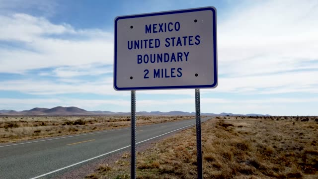 sign indicates the united states and mexico border is up ahead as the united states government continues its shutdown over a fight to fund more... - government shutdown stock videos & royalty-free footage