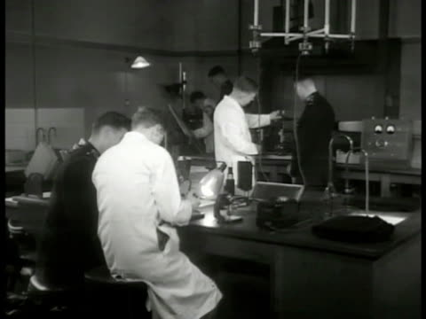 sign int ws instructors students working in laboratory ms instructor w/ student at table w/ book ms instructor w/ student microscope cu student... - detective stock videos and b-roll footage