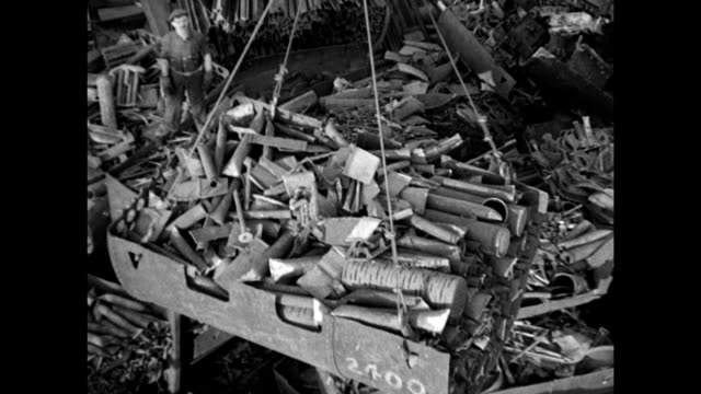 sign 'iron scrap steel.' crane w/ metal scraps moving over metal junk yard. alligator shears cutting metal pieces. wrecking ball 'skull crackers'... - metal stock videos & royalty-free footage