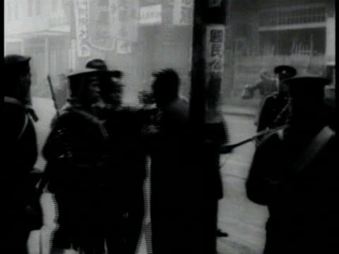 sign: japanese general store. japanese soldiers in shanghai street. artillery in field firing bombarding chapei buildings exploding on fire people... - 1932 stock videos & royalty-free footage