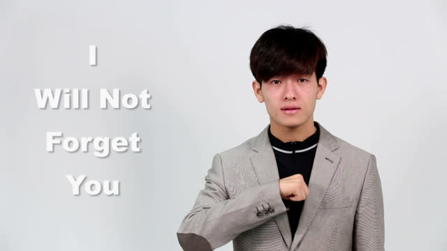 "sign language by asian man in suit jacket over gray background, mean ""i will not forget you"" - suit jacket stock videos & royalty-free footage"