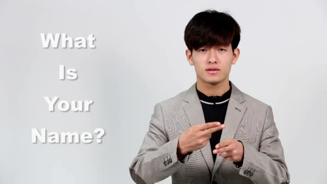 "sign language by asian man in suit jacket over gray background, mean ""what is your name, what are you doing"" - suit jacket stock videos & royalty-free footage"