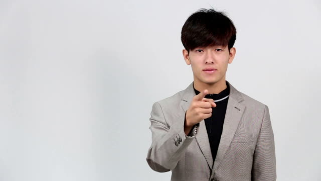 "sign language by asian man in suit jacket over gray background, mean ""what is your dream"" - suit jacket stock videos & royalty-free footage"