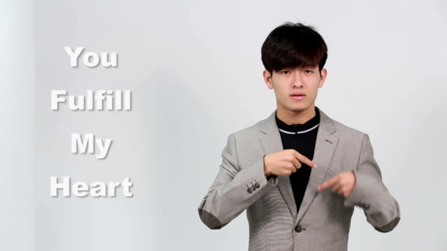 "sign language by asian man in suit jacket over gray background, mean ""you fulfill my heart"" - suit jacket stock videos & royalty-free footage"