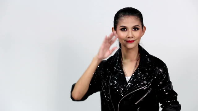 "sign language by asian woman in suit jacket over gray background, mean ""we are all connected"" - suit jacket stock videos & royalty-free footage"