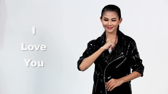 "sign language by asian woman in suit jacket over gray background, mean ""i love you"" - suit jacket stock videos & royalty-free footage"