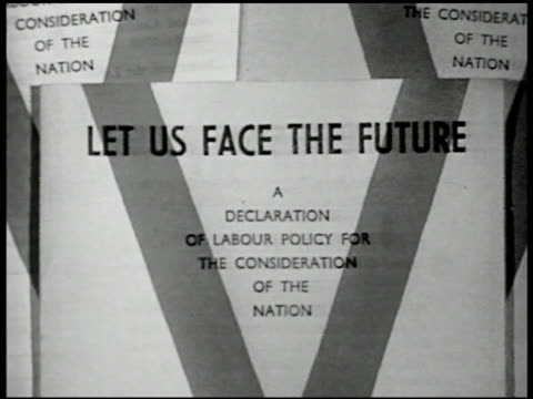sign 'let us face the future' int ws executive committee members of labor party at table meeting ms prime minister clement attlee amp member ernest... - 労働党点の映像素材/bロール