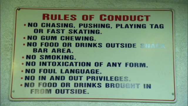 sign listening rules of conduct... no chasing... no gum chewing, no food or drinks... no smoking, no intoxication..., no foul language, no in and out... - no smoking sign stock videos & royalty-free footage