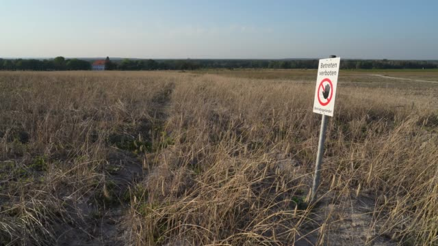 a sign marks the end of a landscaped portion of land that was once torn open by the welzow sued openpit coal mine and is now undergoing recultivation... - landscaped stock videos & royalty-free footage
