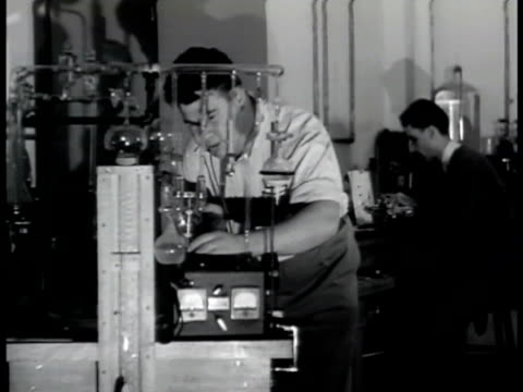 sign: naval research lab. chemist, scientist w/ liquid in large round beaker. chemist w/ small beakers. man looking into oscilloscope . man working... - radar stock videos & royalty-free footage