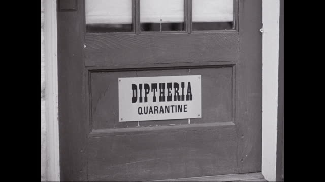 cu sign of diphtheria on hospital door/ united states - diphtherie stock-videos und b-roll-filmmaterial