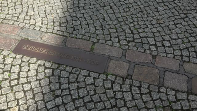 stockvideo's en b-roll-footage met sign of former berlin wall at kochstrasse, berlin, germany, europe - kassei
