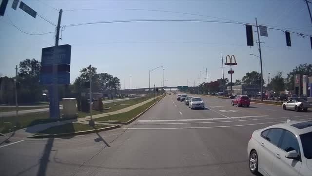 sign of mcdonald's fast food restaurant in a small town amid the global coronavirus pandemic. - road trip stock videos & royalty-free footage
