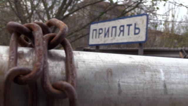 "stockvideo's en b-roll-footage met sign of ""pripyat"" - a town which served the chernobyl npp - kernramp van tsjernobyl"