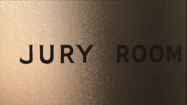 "a sign on a door reads ""jury room."" - hd format stock videos & royalty-free footage"