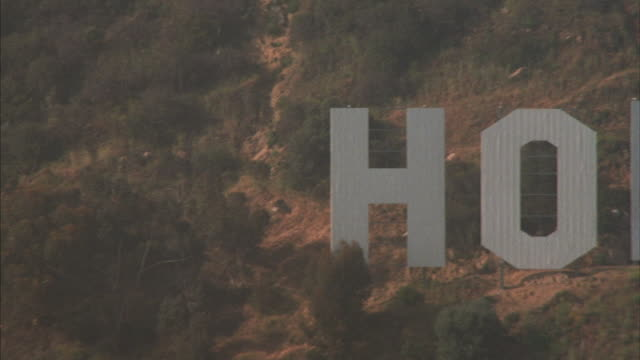 A sign on a hillside reads Hollywood.