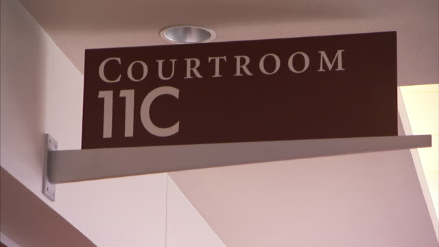 a sign on a wall reads, courtroom 11c. - court room stock videos & royalty-free footage
