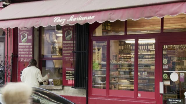 vidéos et rushes de a sign on an awning of a french grocery store. available in hd. - store