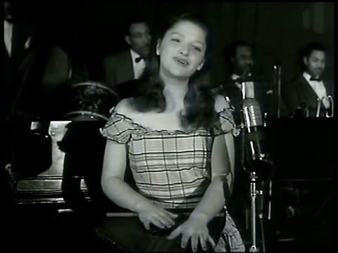 sign on awning cafe society. susan reed sitting singing irish ballad song 'cockles and mussels' while playing zither. female hands strumming zither.... - awning stock videos & royalty-free footage