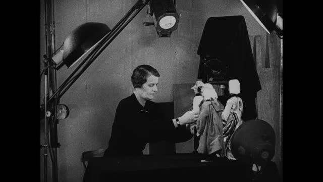 sign on door 7179 45th street russian grand duchess marie pavlovna setting up russian handmade dolls in front of mounted photograph camera cu duchess... - nazionalità russa video stock e b–roll