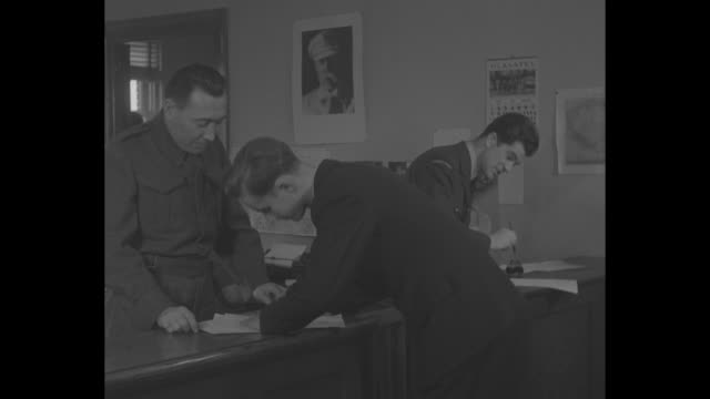 "stockvideo's en b-roll-footage met sign on door ""czechoslovak military mission in canada"" / men entering door / recruits signing applications / closer view signing document / man... - military recruit"