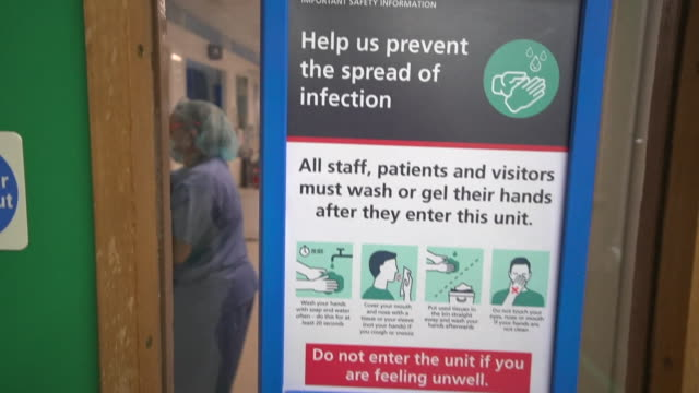 sign on door of hospital ward in london with instructions of how to help stop the spread of coronavirus - instructions stock videos & royalty-free footage