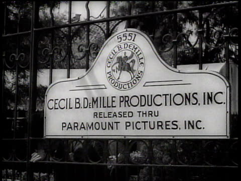 vídeos y material grabado en eventos de stock de sign on gate of cecil b. demille productions studio / hollywood, california, united states - 1930 1939