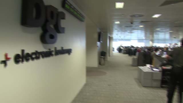 bgc sign on interior wall pan lr office space traders working at computers and speaking on telephones pan rl bgc sign on wall / general view office... - general view stock videos and b-roll footage
