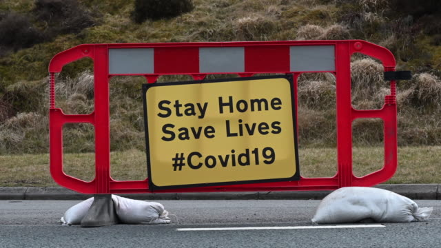 a sign on the a470 near pen y fan warns motorists to stay at home to save lives on march 28 in brecon wales last weekend the area was busy with... - national park stock videos & royalty-free footage