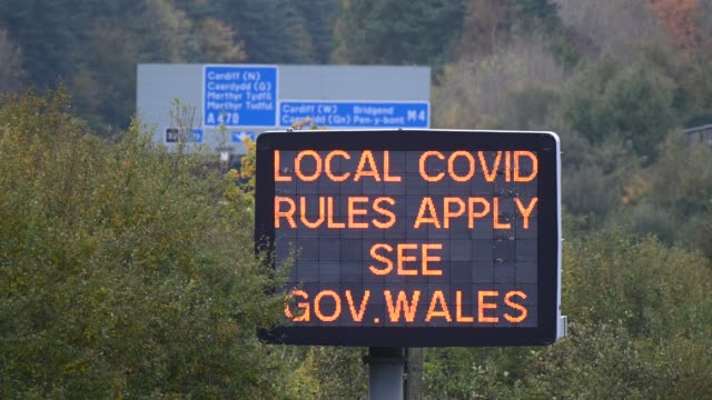 sign on the m4 motorway warns of local covid rules on october 16 in cardiff, wales. the welsh first minister mark drakeford said that people from... - major road stock videos & royalty-free footage