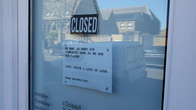 a sign on the window of mac and miller displays it is closed during the coronavirus pandemic on march 23 2020 in east dulwich london england - brian dayle coronavirus stock videos & royalty-free footage