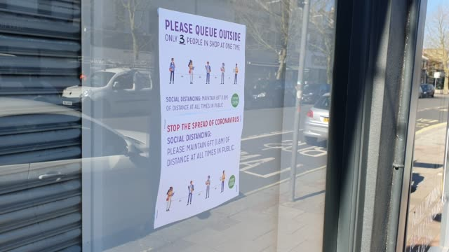 a sign on the window of pearspring in east dulwich explains social distancing during the coronavirus pandemic on march 25 2020 in london england - brian dayle coronavirus stock videos & royalty-free footage